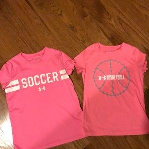 Pair of pink girls' UA Heatgear sports tees